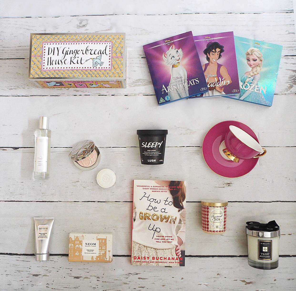 Christmas Gift Guide 2018; Biscuiteers Gingerbread, Disney classics blu rays, the white company winter, lush sleepy, bombay duck teacup, laura mercier hand cream, how to be a grown up book, jo malone macaroon
